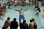 belly flop,ship,board,contest, man,pool,competition ,belly, water,pool,people,looking,on, flop,