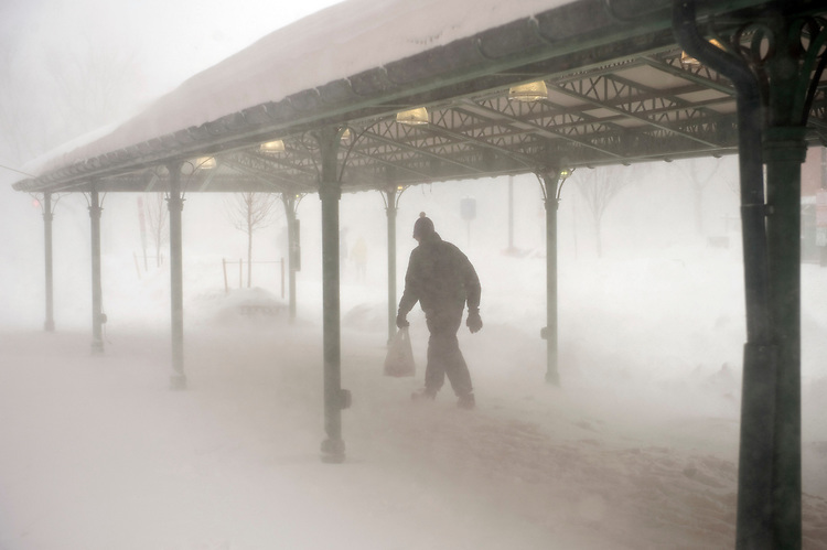 A man braves the wind outside of Eastern Market during a winter storm expected to bring 10-15 inches of snow in the District with gust of winds near 40 miles per hour, Feb. 10, 2010.
