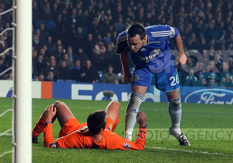 Chelsea's John Terry, right, has words to Valencia's Carlos Marchena during their UEFA Champions League, Group B football match, at Stamford Bridge Stadium, London, 11th December 2007.