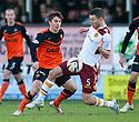 Motherwell's Simon Ramsden challenges Dundee Utd's Charlie Telfer.