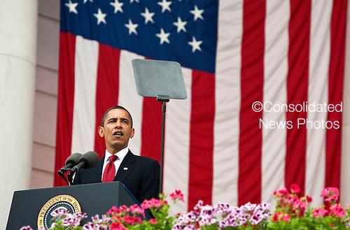 Arlington, VA - May 25, 2009 -- United States President Barack Obama speaks during Memorial Day Ceremonies at Arlington National Cemetery in Arlington, VA, U.S.,  Monday, May 25, 2009. .Credit: Joshua Roberts - Pool via CNP.