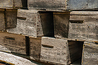 Old grape crates are stacked on a wagon at Gundlach Bundschu Winery in Sonoma County, California