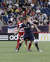 New England Revolution midfielder Marko Perovic (29) blocks FC Dallas midfielder/forward Dax McCarty(13) as he receives the ball.  The New England Revolution drew FC Dallas 1-1, at Gillette Stadium on May 1, 2010