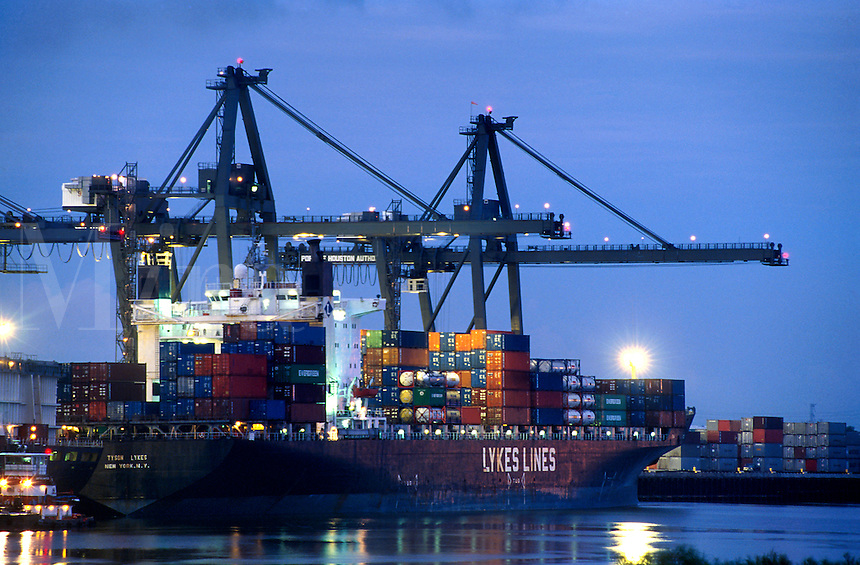 Twilight view of cranes loading a ship from the Lykes shipping line at a container terminal.