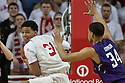March 1, 2014: Shavon Shields (31) of the Nebraska Cornhuskers gets the rebound with Sanjay Lumpkin (34) of the Northwestern Wildcats guarding during the first half at the Pinnacle Bank Arena, Lincoln, NE. Nebraska 54 Northwestern 47.