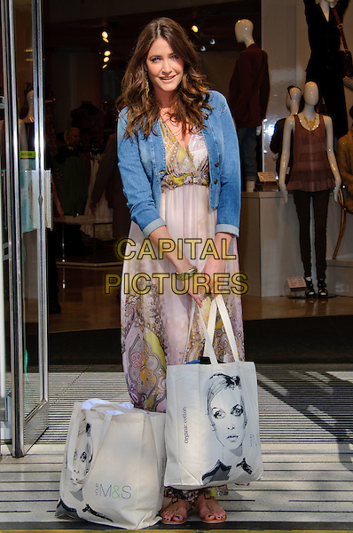 LISA SNOWDON.Lisa Snowdon launches M&S campaign encouraging customers to donate clothes to Oxfam at Marks & Spencer Marble Arch,  London, England..March 23rd, 2011 .blue denim jean grey gray green print side full length jacket maxi dress bags .CAP/CJ.©Chris Joseph/Capital Pictures.