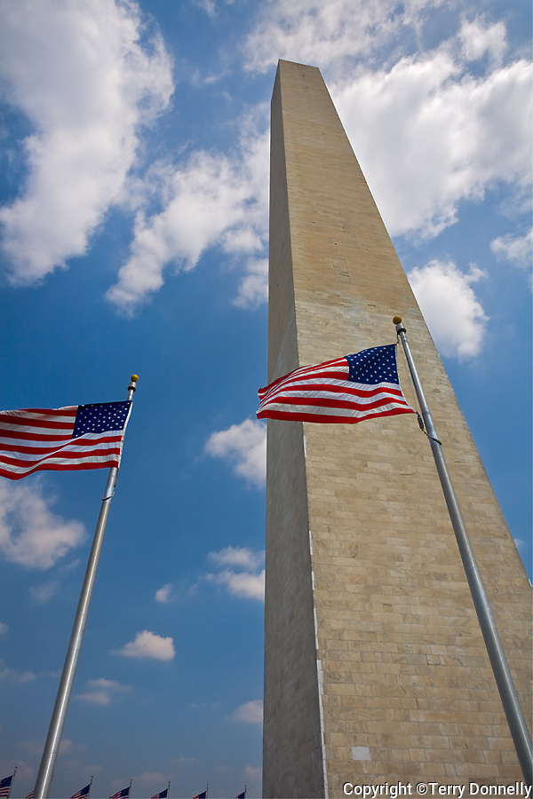 Washington, DC<br /> Washington monument (1884) a 555 ft. obelisk with American flags surrounding the base