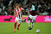 Arthur Masuaku of West Ham United and Moritz Bauer of Stoke City during West Ham United vs Stoke City, Premier League Football at The London Stadium on 16th April 2018