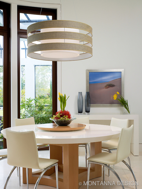 Breakfast Nook is white on white with giant double tiered drum pendant.