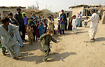 People in a Pakistani village dance for a visitor.