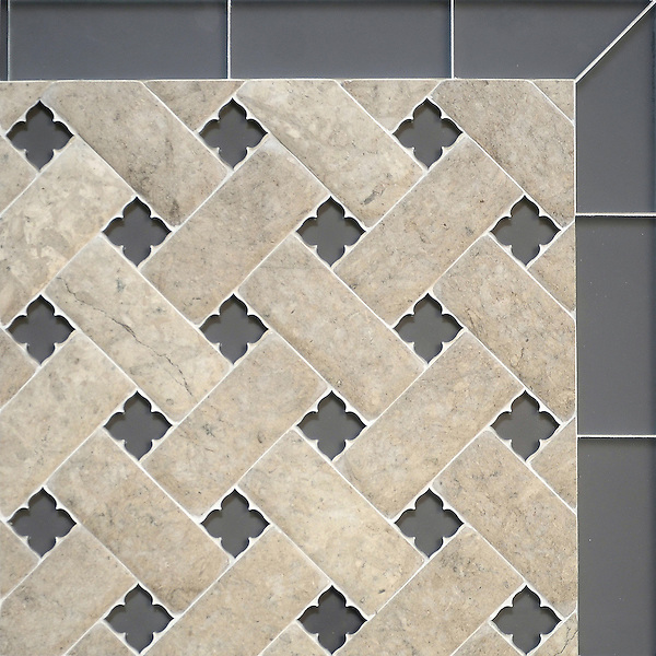 Fraser, a stone waterjet mosaic, shown in Palomar Venetian honed and Warm Grey glass flowers with honed Warm Grey glass bricks, is part of the Altimetry® collection for New Ravenna.