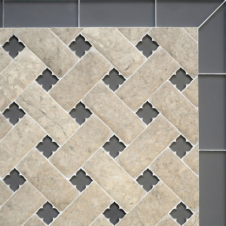 Fraser, a stone waterjet mosaic, shown in Palomar Venetian honed and Warm Grey Serenity glass flowers with matte Warm Grey Serenity glass bricks, is part of the Altimetry® collection for New Ravenna.