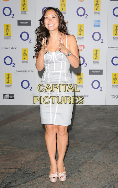 MYLEENE KLASS .At the O2 Silver Clef Awards, Hilton Park Lane hotel, London, England, UK, July 2nd 2010..full length white grey gray silver bustier dress beige cream platform peep toe shoes bows hands funny gesture smiling .CAP/CAN.©Can Nguyen/Capital Pictures.