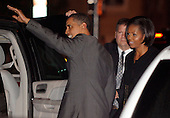 United States President Barack Obama waves to onlookers as he and first lady Michelle Obama prepare to get  into their SUV after the couple dined in Northwest Washington, DC, USA, 16 January 2010.  17 January is Michelle's birthday and the couple joined numerous friends for a surprise birthday party away from the White House.      .Credit: Mike Theiler - Pool via CNP