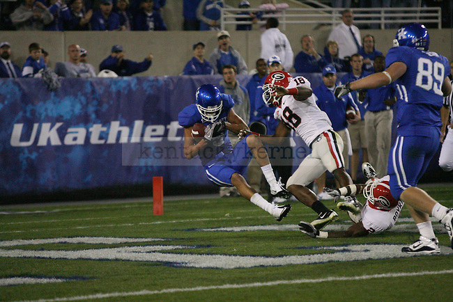 Junior wide receiver Matt Roark catches a ball in the middle of defenders for a two-point conversion in the second half of UK's home game against the Georgia Bulldogs at Commonwealth Stadium, Saturday, Oct. 23, 2010. Photo by Brandon Goodwin | Staff