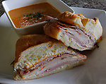 The Club Heaven has turkey, chicken, roast beef, ham, Italian herb cheese, three-pepper Colby Jack cheese and Garlic Lemon Mayo on a Croissant. This order has a bowl of tomato basil soup as well.