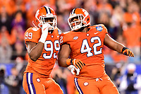 Charlotte, NC - DEC 2, 2017: Clemson Tigers defensive end Clelin Ferrell (99) and Clemson Tigers defensive lineman Christian Wilkins (42) celebrate a sack during ACC Championship game between Miami and Clemson at Bank of America Stadium Charlotte, North Carolina. (Photo by Phil Peters/Media Images International)