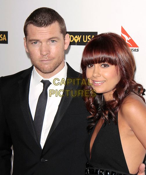SAM WORTHINGTON & NATALIE MARK.Attending the 2010 G'Day USA Australia Week Black Tie Gala held at the Hollywood & Highland Grand Ballroom, Hollywood, California, USA, .16th January 2010. .arrivals half length black suit tie couple  studs studded low cut fringe beard facial hair .CAP/RKE/DVS .©DVS/RockinExposures/Capital Pictures