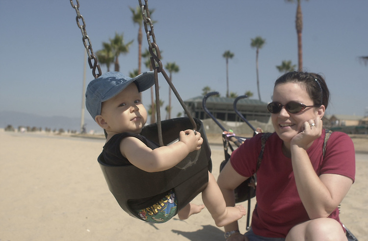 DNCconvention7(TW)081700 -- 15 month old Reece and mom Tracy enjoy the swings on Venice Beach.