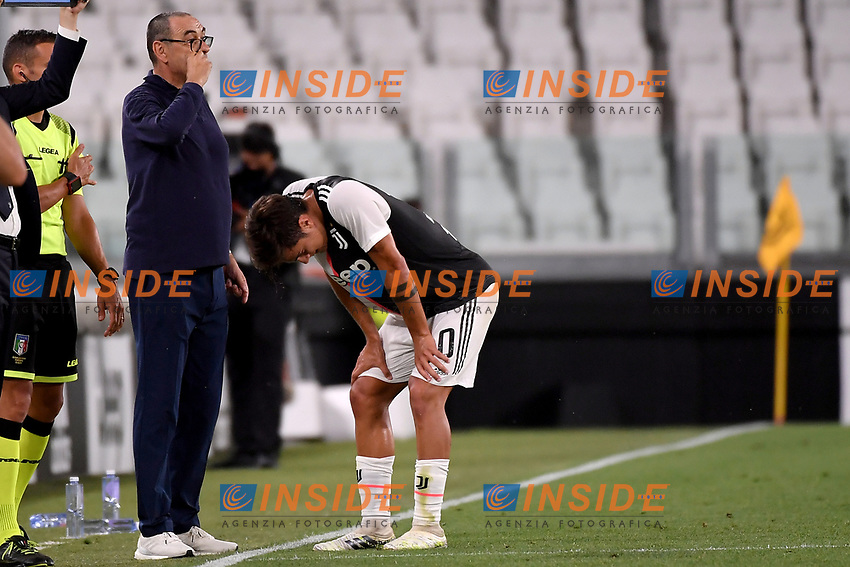 Paulo Dybala of Juventus injured in front of his coach Maurizio Sarri during the Serie A football match between Juventus FC and UC Sampdoria at Juventus stadium in Turin (Italy), July 26th, 2020. Play resumes behind closed doors following the outbreak of the coronavirus disease. <br /> Photo Federico Tardito / Insidefoto
