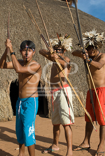 Xingu Indigenous Park, Mato Grosso State, Brazil. Aldeia Moygu (Ikpeng). Resian Kawire Ikpeng, Tawarero Ikpeng and Payata Ikpeng, angry at the construction of dams affecting indigenous territories.