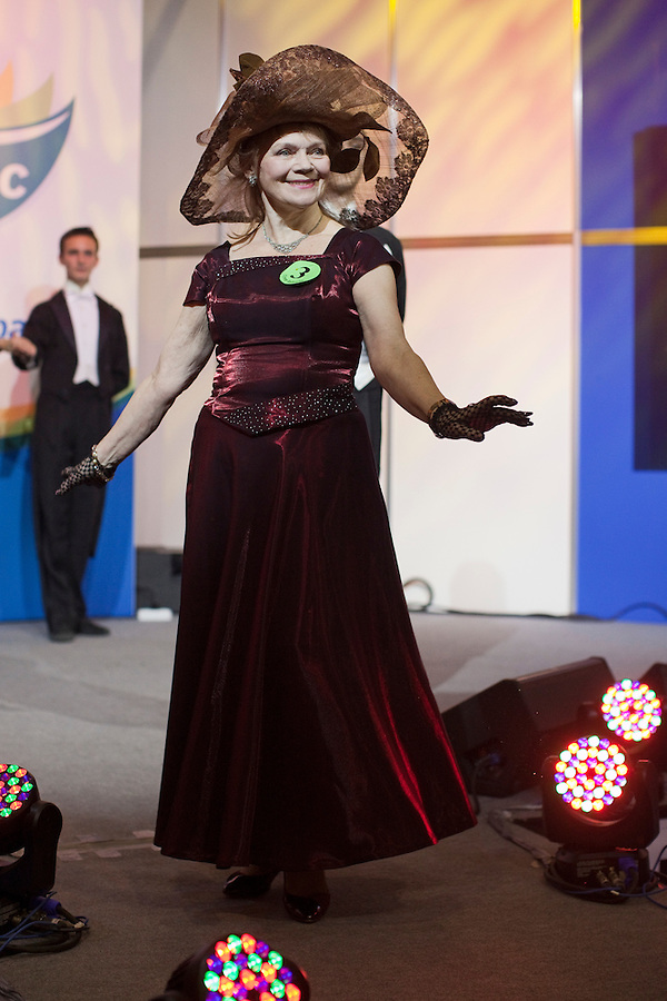 Moscow, Russia, 02/11/2011..A competitor onstage at the first Moscow Super-Babushka contest. A total of 105 women aged over 50 entered to compete for various titles, including most stylish, modern, elegant, business-minded, creative, artistic, and cheerful granny. The overall winning title of Super-Babushka was taken by 73 year old Ludmilla Trafinovna in the event organised by the Moscow City Government Social Welfare Department.