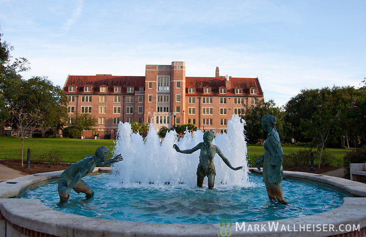 Photographs of the Landis Green Legacy Fountain on the campus of Florida State University designed and sculpted by Edward jonas.  the sculptures are of six life sized bronze figures.  These pictured are of contemporary life on the FSU campus.  The three on the other side depict an era when the university was the Florida State College for Women.