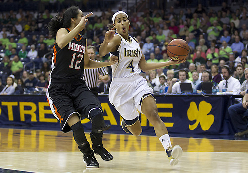 November 20, 2012:  Notre Dame guard Skylar Diggins (4) drives to the basket as Mercer guard Jessica Prieto (12) defends during NCAA Women's Basketball game action between the Notre Dame Fighting Irish and the Mercer Bears at Purcell Pavilion at the Joyce Center in South Bend, Indiana.  Notre Dame defeated Mercer 93-36.