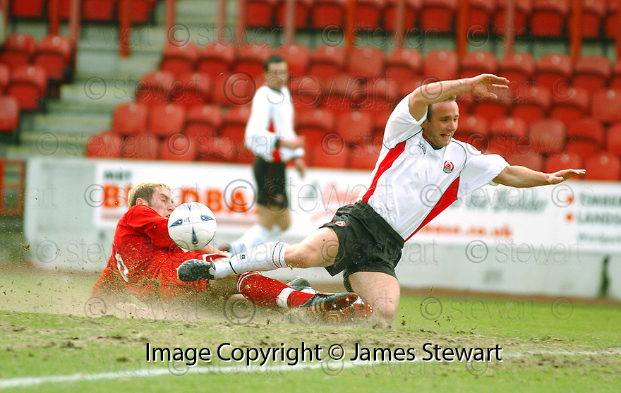 20040327     Copyright Pic : James Stewart.File Name : jspa02_clyde_v_stmirren.IAN HARTY IS BROUGHT DOWN BY KIRK BROADFOOT FOR CLYDE'S PENALTY...James Stewart Photo Agency 19 Carronlea Drive, Falkirk. FK2 8DN      Vat Reg No. 607 6932 25.Office     : +44 (0)1324 570906     .Mobile  : +44 (0)7721 416997.Fax         :  +44 (0)1324 570906.E-mail  :  jim@jspa.co.uk.If you require further information then contact Jim Stewart on any of the numbers above.........