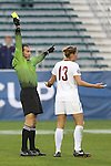 08 December 2013: Referee Terry Vaughn shows the yellow card to Florida State's Kristen Grubka (13). The Florida State University Seminoles played the University of California Los Angeles Bruins at WakeMed Stadium in Cary, North Carolina in a 2013 NCAA Division I Women's College Cup championship game.