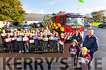 Students Tamica O'Connor and Sean Hennessy with Mary Quirke, Building Control Officer, and Nigel Corner, Station Officer with Principal Ed O'Brian and  3rd class of Holy Family Tralee launching the National Fire Safety Week Schools Art Competition from the 5th - 11th October 2015