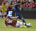 Matteo Gabbia (46, left) of Milan tries to get the ball from Alphonso Davies (19) of Bayern Munich during their International Champions Cup match on July 23, 2019 at Children's Mercy Park in Kansas City, KS.<br /> Tim VIZER/AFP