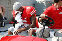Ohio State Buckeyes quarterback Braxton Miller (5) is carted off the field with a knee injury during the first quarter of the NCAA football game against San Diego State at Ohio Stadium in Columbus on Sept. 7, 2013. (Adam Cairns / The Columbus Dispatch)