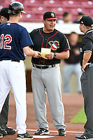 Quad Cities River Bandits manager Omar Lopez (22) during the lineup exchange with Jake Mauer (12) before a game against the Cedar Rapids Kernels on August 18, 2014 at Perfect Game Field at Veterans Memorial Stadium in Cedar Rapids, Iowa.  Cedar Rapids defeated Quad Cities 5-3.  (Mike Janes/Four Seam Images)