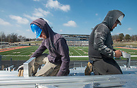 NWA Democrat-Gazette/BEN GOFF @NWABENGOFF<br /> Gustavo Armendariz (left) and Harley Saavedra with a crew from Southern Trades, Inc. out of Louisville, Ky., install new bleachers Thursday, March 1, 2018, in Gates Stadium at Rogers Heritage High. The stadium is getting all new aluminum bleachers on both the home and visitor sides, as well as a new walkway on the front of the home side.
