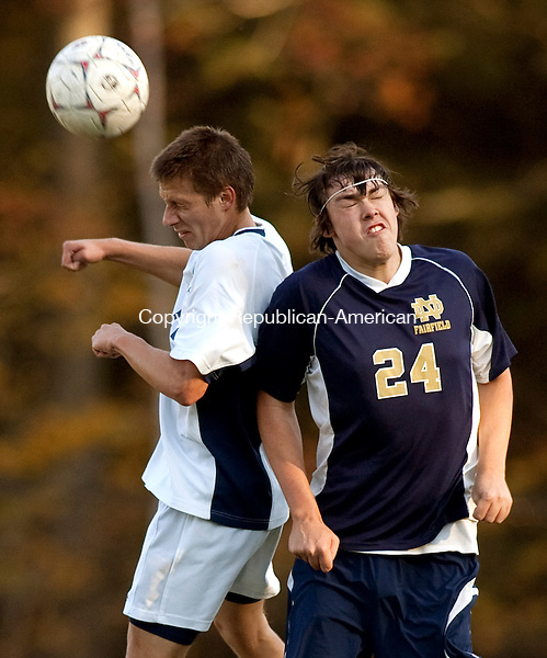 OXFORD, CT, 19 OCTOBER 2010-101910JS09-Oxford's Alex Niski (12), heads the ball in front of Notre Dame-Fairfield's Ryan Connolly (24) during their game Tuesday at Oxford High School. <br />  Jim Shannon Republican-American