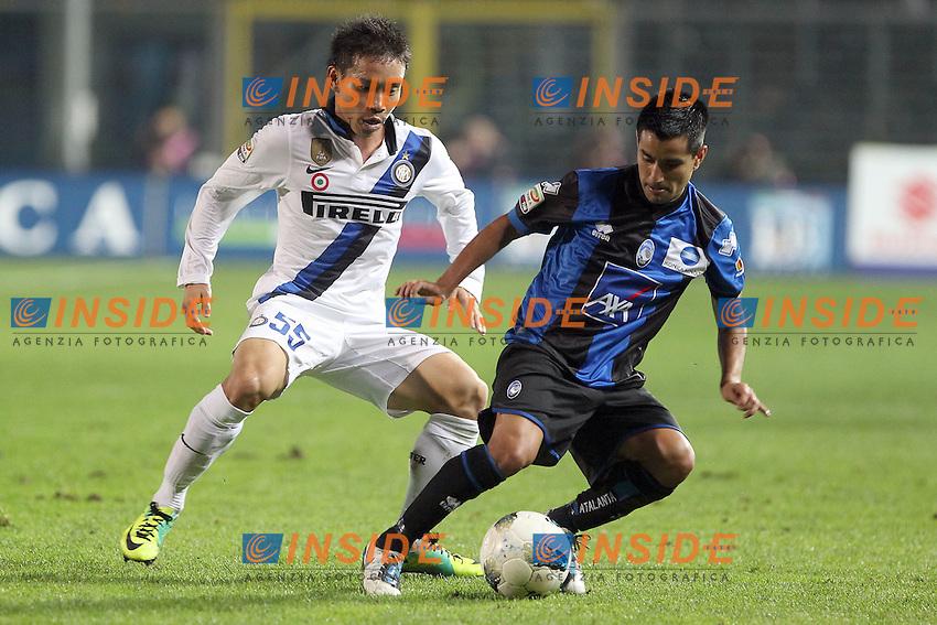 """Yuto Nagatomo Inter Maximiliano Moralez Atalanta..Bergamo, 26/10/2011 Stadio """"Atleti Azzurri d'Italia""""..Football Calcio Serie A 2011/2012..Atalana vs Inter 1-1..Foto Insidefoto Paolo Nucci"""