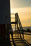 Plum Bank Road, Route 154, Saybrook, CT.  Beach front house staircase silhouetted.