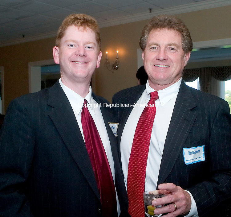 WATERBURY- 16 MAY 06- 051606JT11- <br /> Chris Drew, member of the Connecticut Estate and Tax Planning Council, Inc., with Rus Hauswirth of Highland Capital Brokerage in Farmington, at the council's 70th anniversary annual meeting at the Country Club of Waterbury on Tuesday, May 16.<br /> Josalee Thrift Republican-American