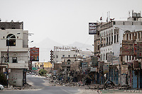 Wednesday 15 July, 2015: Destroyed buildings are seen in a market street in the downtown of Sa'dah, a city subdued to heavy bombarments carried out by the Saudi-led coalition air force in the northern province of Sa'dah, the stronghold of the Houthi's movement in Yemen. (Photo/Narciso Contreras)