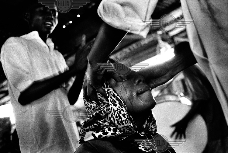 ©Dieter Telemans/Panos Pictures..Sects in Kinshasa, Congo..The church of 'Ma Jolie' in Matete (Kinshasa) is specialised in the healing of witches. Ma Jolie is a priest who received a special gift: by praying she knows who is attained by witchcraft. Photo:  Dieter Telemans / Panos Pictures/Felix Features