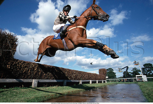 FONTWELL PARK National Hunt Horse Racing, 970904. Photo: Glyn Kirk/Action Plus...1997.water jump.remote.national hunt.steeplechase.steeplechasing.jumps.equestrian sports