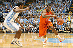 02 February 2013: Virginia Tech's Robert Brown (right) and North Carolina's Dexter Strickland (left). The University of North Carolina Tar Heels played the Virginia Tech Hokies at the Dean E. Smith Center in Chapel Hill, North Carolina in an NCAA Division I Men's college basketball game. UNC won the game 72-60 after overtime.