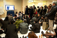 People watching TV news of the earthquake in the Prince Hotel, Shinagawa, Tokyo, 11 March 2011. After a huge earthquake in north-east Japan several million people in Tokyo struggle to return home.
