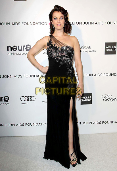 Bellamy Young.21st Annual Elton John Academy Awards Viewing Party held at West Hollywood Park, West Hollywood, California, USA..February 24th, 2013.oscars full length black one shoulder slit split lace dress sheer hand on hip.CAP/ADM/KB.©Kevan Brooks/AdMedia/Capital Pictures.