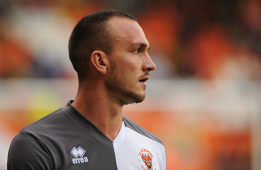 Blackpool's Tom Aldred during the pre-match warm-up <br /> <br /> Photographer Kevin Barnes/CameraSport<br /> <br /> Football - The Football League Sky Bet League One - Blackpool v Burton Albion - Tuesday 18th August 2015 - Bloomfield Road - Blackpool<br /> <br /> &copy; CameraSport - 43 Linden Ave. Countesthorpe. Leicester. England. LE8 5PG - Tel: +44 (0) 116 277 4147 - admin@camerasport.com - www.camerasport.com
