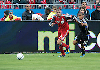 24 March 2012: Toronto FC forward Danny Koevermans #14 and San Jose Earthquakes defender/midfielder Justin Morrow #15 in action during a game between the San Jose Earthquakes and Toronto FC at BMO Field in Toronto..The San Jose Earthquakes won 3-0..