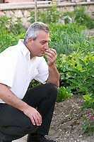 Nikos Kontosoros, The owner. In the kitchen vegetable potager garden. Kontosoros restaurant and guest house, Xino Nero, Amyndeo, Macedonia, Greece