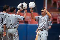 Lehigh Mountain Hawks second baseman Mike Garzillo (2) congratulated by Jacen Nalesnik (19) and David Young (1) after hitting a home run during a game against the Dartmouth Big Green on March 20, 2016 at Chain of Lakes Stadium in Winter Haven, Florida.  Dartmouth defeated Lehigh 5-4.  (Mike Janes/Four Seam Images)