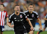 Washington D.C. - July 21, 2014: Perry Kitchen (23) of D.C. United celebrates his score.  D.C. United defeated the Chivas USA 3-1 during a Major League Soccer match for the 2014 season at RFK Stadium.